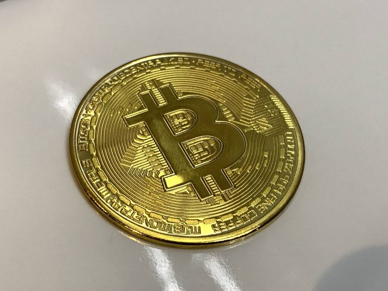 Bitcoin on Shiny Glossy White Surface