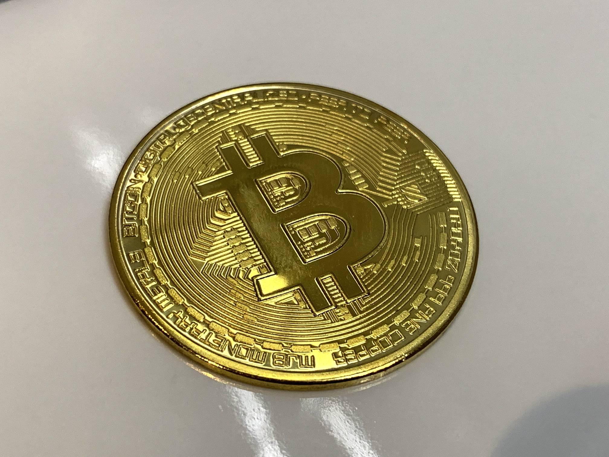 Bitcoin on Shiny Glossy White Surface