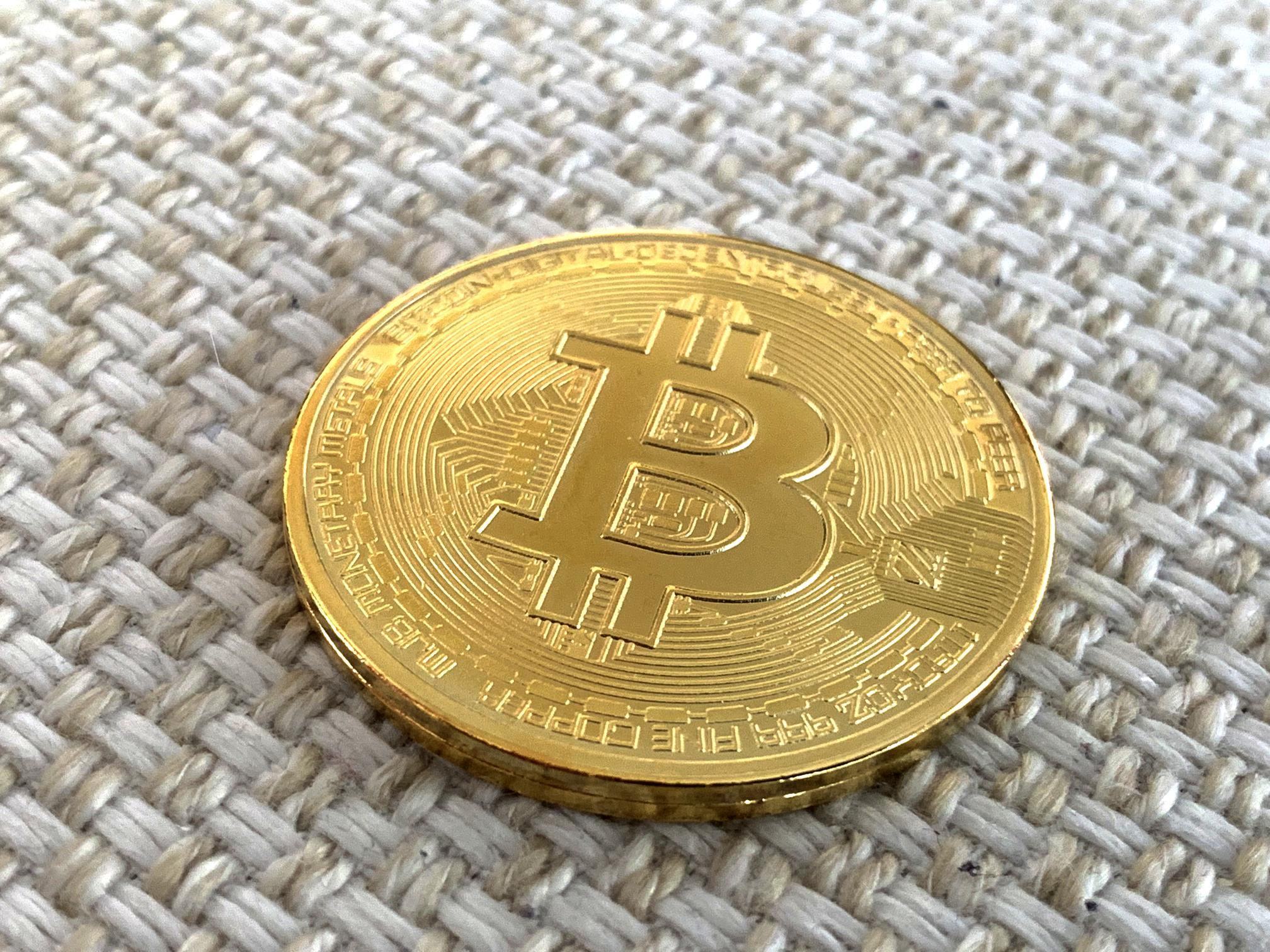 Bitcoin on White Textile