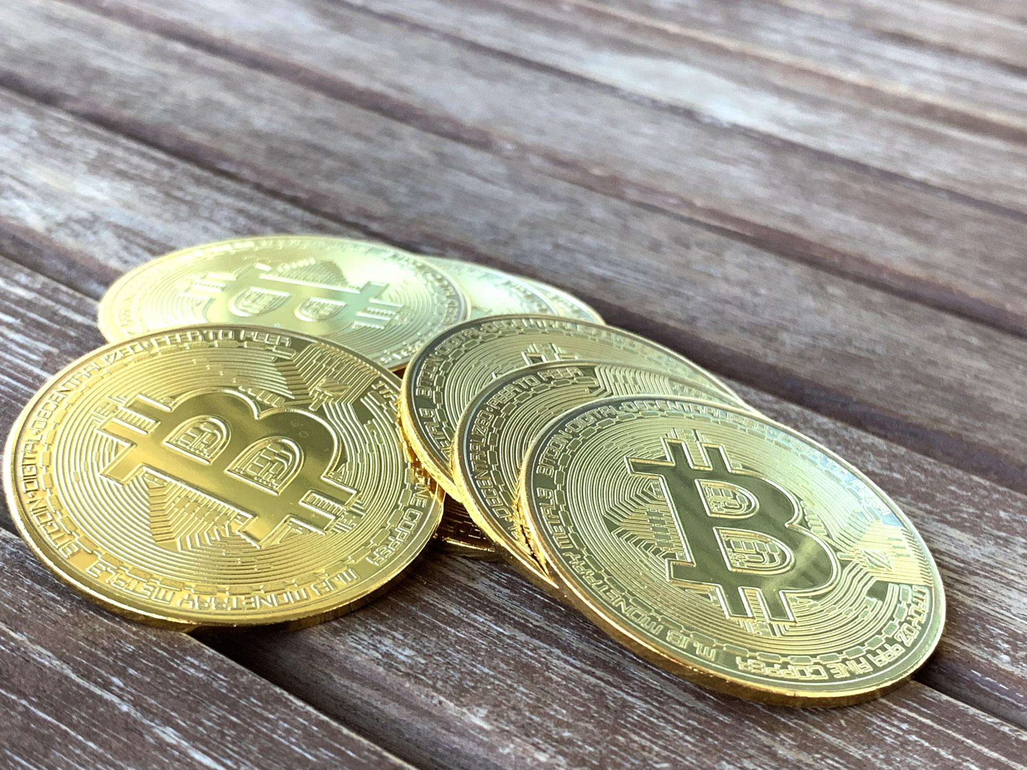 Bitcoin stack on wooden surface